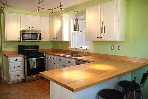 Green and wood matching styles kitchen design