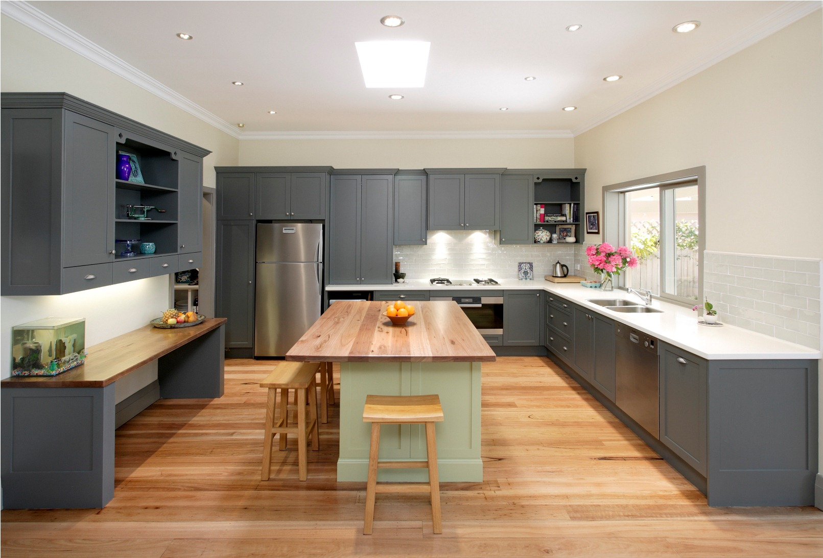 Wood style table top and flooring with grey kitchen cabinets