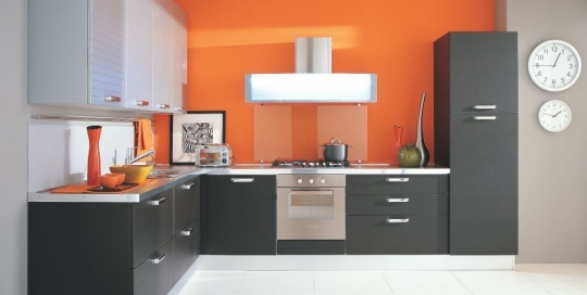 Modern orange backsplash and black kitchen cabinets design