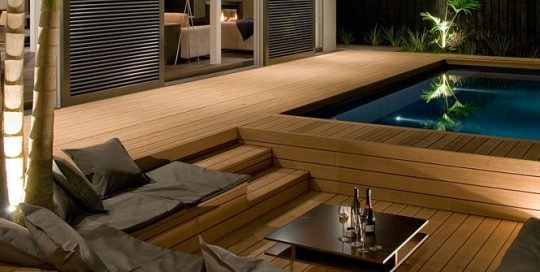 Outdoor luxury swimming pool timber deck.