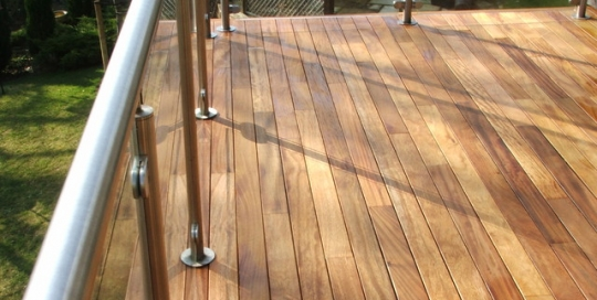 Outdoor timber deck balcony with glass and stainless steel balustrade