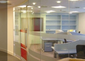 Curved glass partition.