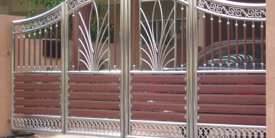 Stainless steel main gate with wooden plate