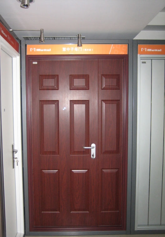 Solid wood unequal double door with nice natural wood grain.
