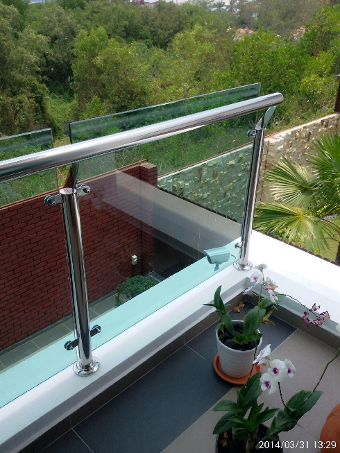 Balcony stainless steel with glass panel balustrade.