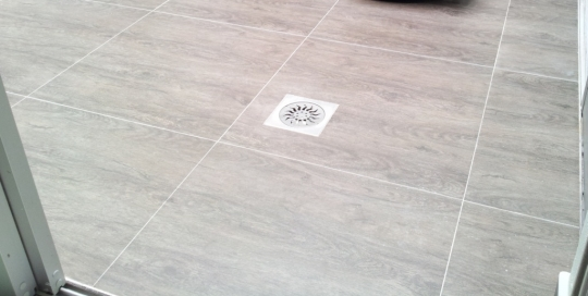 600mm x 600mm wood finish ceramic tiles with stainless steel floor trap cover