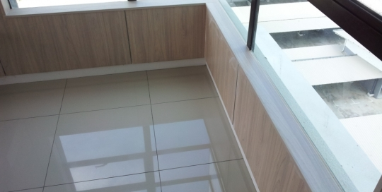 Formica laminated wood feature wall and formica laminated wood window stool